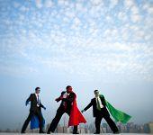 Superhero businessmen in front of New York City.