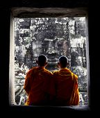 Contemplating monk, Angkor Wat, Siam Reap, Cambodia.