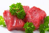 detail of raw beef chunks with parsley