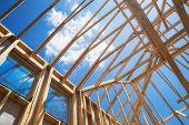 New Construction Home Framing Against Blue Sky