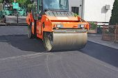 picture of tar  - Compactor roller during road construction at asphalting work - JPG