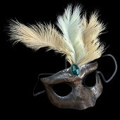 metal carnival mask with feathers on isolate black