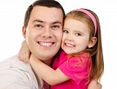 Portrait Of Smiling Father And Daughter Isolated