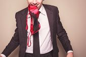 pic of adultery  - A seductive businessman has a bra in his mouth - JPG