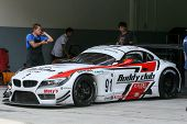 SEPANG, MALAYSIA - MAY 10, 2014: The BMW car of Jun San Chen and Ollie Millroy leaves to start the f