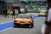 SEPANG, MALAYSIA - MAY 10, 2014: The race cars return to the pit lane after the free practice sessio