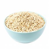 Oat Flakes For Breakfast Isolated  On White Background. Healthy Homemade Oatmeal Breakfast In A Bowl