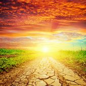 red sunset over drought road