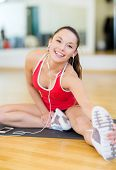 fitness, sport, training, gym, technology and lifestyle concept - smiling teenage girl with smartpho