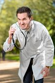 Crazy Doctor With Stethoscope On Green Background