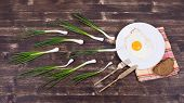 stock photo of ovulation  - Egg chives plate knife and fork look like sperm competition Spermatozoons floating to ovule - JPG