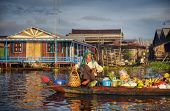 Local Cambodian seller in floating market.