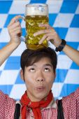 Asian Man Having Oktoberfest Beer Stein  Head And Looks Surprised