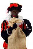Zwarte Piet (zwarte Pete) typisch Nederlandse karakter met zak