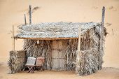 stock photo of oman  - Reed cabin desert camp Wahiba in Oman - JPG