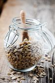 Close up of sunflower seeds in glass jar