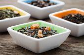 Fresh green tea leaves with jasmine flowers