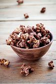 Chocolate pop corn in small brown bowl