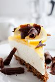 Lemon cheesecake with lemon slice and chocolate curls
