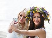Best friends taking a selfie with the phone