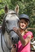 stock photo of great horse  - Young girl with white horse - JPG
