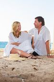 Mature couple at the beach in the summertime