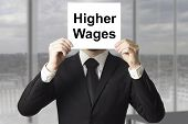 Businessman Hiding Face Behind Sign Higher Wages
