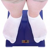 Fat man standing on electronic scales. Conceptual photo of weight loss.
