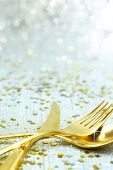 Christmas golden cutlery on festive background