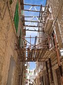 Alley in Molfetta Oldtown with reinforced scaffolding. Apulia.