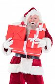 Santa carries a few presents close on white background