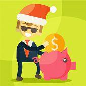 Businessman putting coin into piggy bank, Christmas