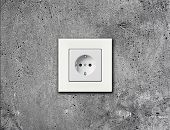 white electric socket on wall
