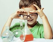 little cute boy with medicine glass isolated