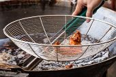 picture of southern fried chicken  - Breaded Chicken Deep Frying In Oil In A Cast Iron Frying Pan  - JPG