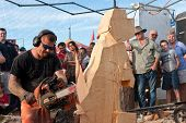 Chainsaw Sculptor Creates Wooden Dog Sculpture