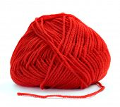 a ball of red yarn for knitting on a white background