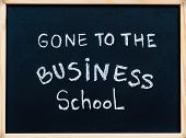 Gone To The Business School Message Written With White Chalk On Wooden Frame Blackboard