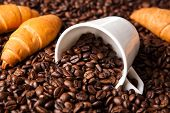 stock photo of inverted  - inverted cup with coffee beans close up - JPG