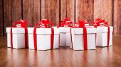 Many White Gift Boxes On A Wood Background