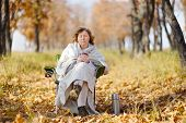 Young Woman In Autumn, Wrapped Up Against The Cold, Cool Hot Tea.