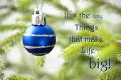 picture of blue things  - Closeup Of A Blue Christmas Ball With Silver Decoration With Life Quote Saying It Is The Little Things That Make Life Big Green Fir Tree Branches In The Background