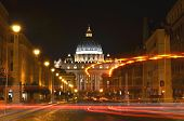 Monumental St. Peters Basilica by night in Vatican City.