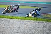 ASSEN, NETHERLANDS - OCTOBER 19, 2014: Competitors racing through the apex of the 1000cc superbike races on the TT Assen circuit