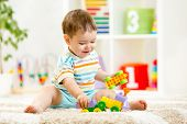 kid playing with building blocks at kindergarten