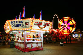 picture of carnival ride  - Food stand at a carnival at night - JPG