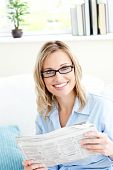 Positive Businesswoman Reading Newspaper In The Office