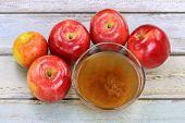pic of cider apples  - Fresh apples and a bowl of raw and unfiltered organic apple cider vinegar with mother enzymes - JPG