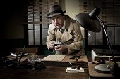 image of caught  - Retro spy agent caught photographing important documents on office desk 1950s style - JPG