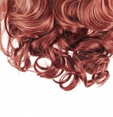 image of auburn  - Curly hair fragment placed over the white background as a copyspace backdrop composition - JPG
